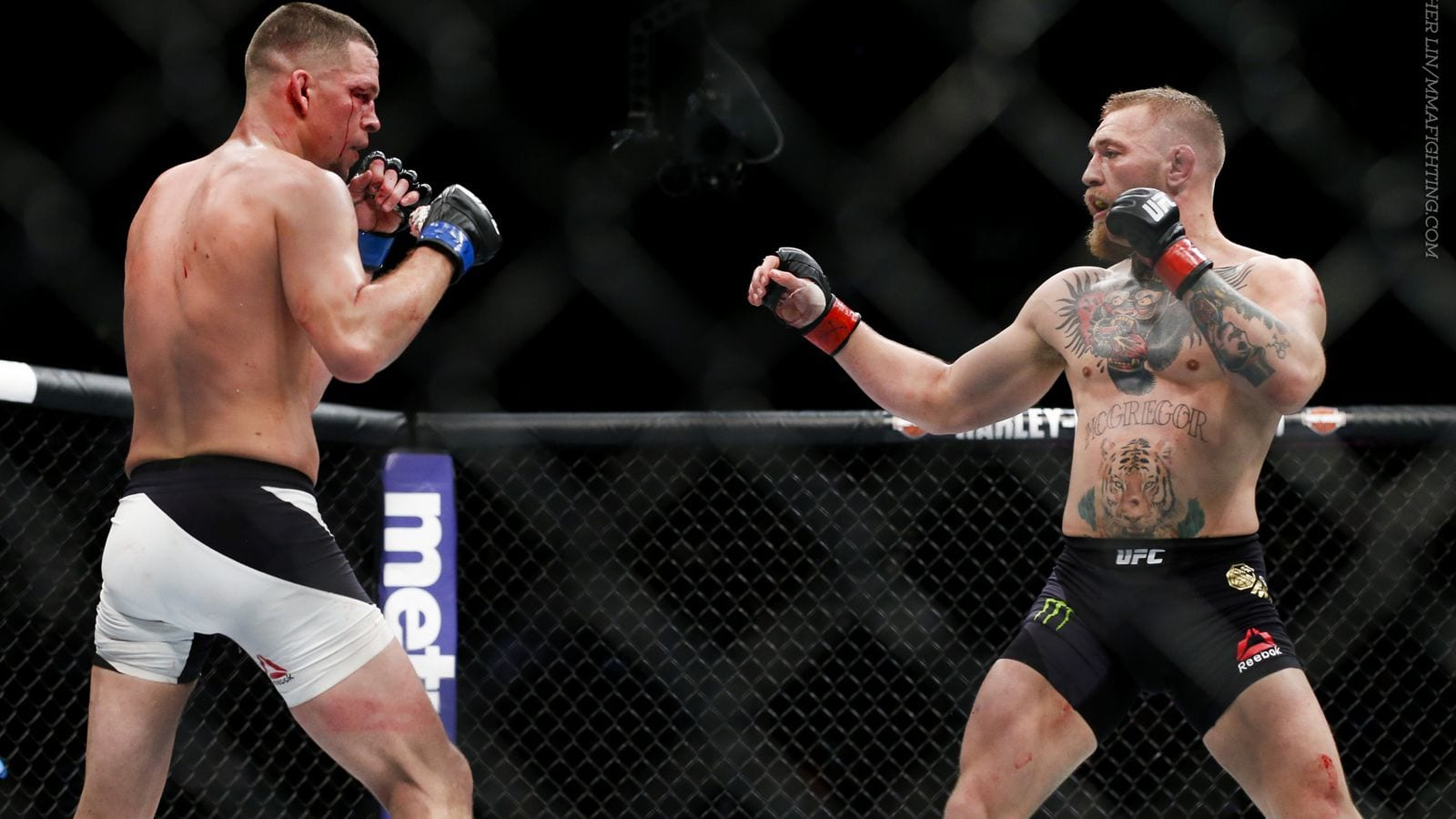 https://news.sportsinteraction.com/wp-content/blogs.dir/1341/files/2016/08/Conor-McGregor-Nate-Diaz-UFC-202.jpg
